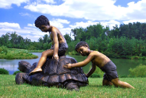 Two Boys Playing with Turtle Fountain