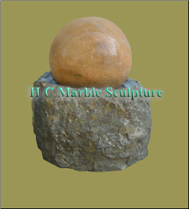 Sunset Red Marble Ball Fountain on Grey Rock