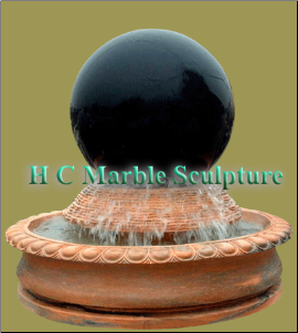 Black Marble Sphere Fountain on Sunset Red Base