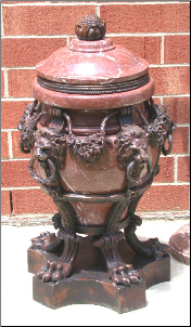 Red Marble Urn with Lion Heads