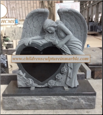 Heart shaped weeping angel tombstones with carved rose