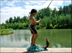 Boy Fishing at Lake Fountain