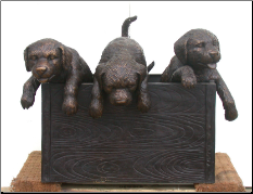Bronze Sculpture of Puppies in a Box