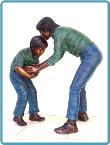 Bronze Statue Mother & Son Playing Football