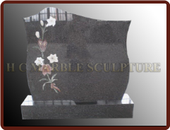 Granite Tombstone W/ Eetched Flowers on The Left