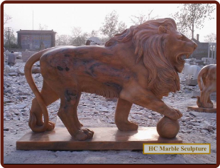 Red Marble Lion Standing on Ball